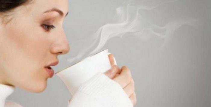 Woman drinking hot Water
