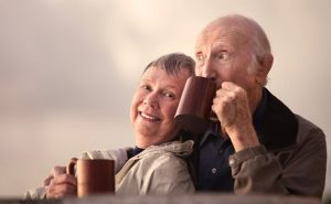 elderly-couple-outside-drinking-coffee
