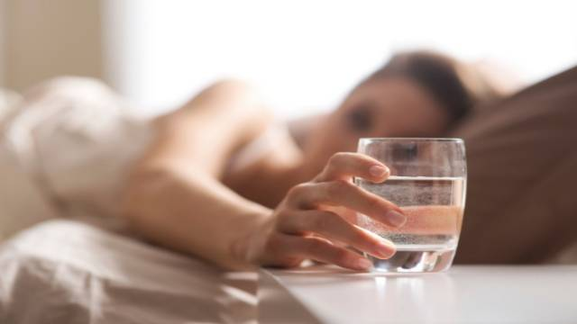 Woman and Glass of Water