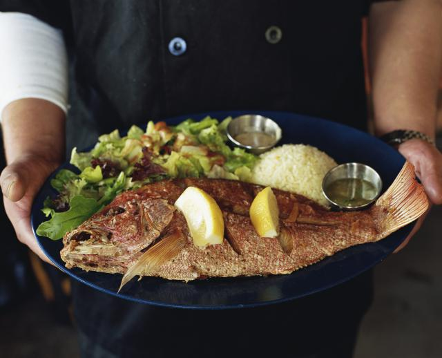 Grilled whole red snapper with salad and rice