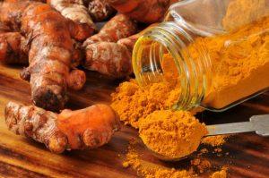 turmeric-roots-and-a-jar-of-turmeric-powder