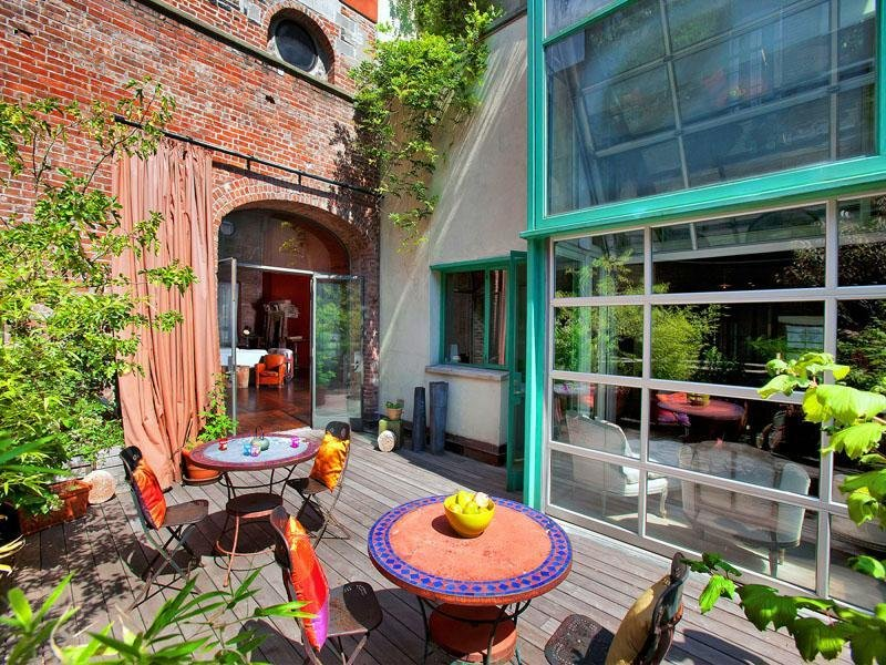 colorful-outdoor-seating-area-serves-sunny-city-oasis