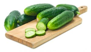 Sliced Cucumbers on Cutting Board. This file is cleaned, retouched and contains clipping path.