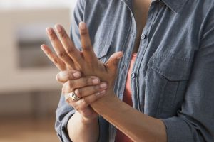 Older-Black-woman-rubbing-her-hands--Arthritis