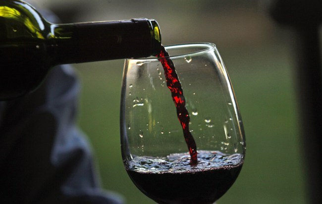 In this Jan. 25, 2014 photo, a man pours a glass of Erasmo wine at the Reserva de Caliboro vineyard in Maule Valley, Chile. A bold new wave of independent vintners are challenging Chile's reputation for producing oceans of agreeable but predictable wines. (AP Photo/Luis Hidalgo)