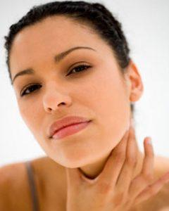 Woman feeling glands