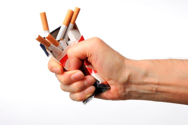Isolated-shot-of-broken-cigarettes-on-white-background