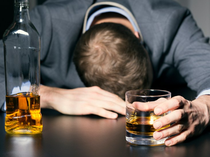 man-with-alcohol-in-hand-and-resting-head-on-table-732x549-thumb_0